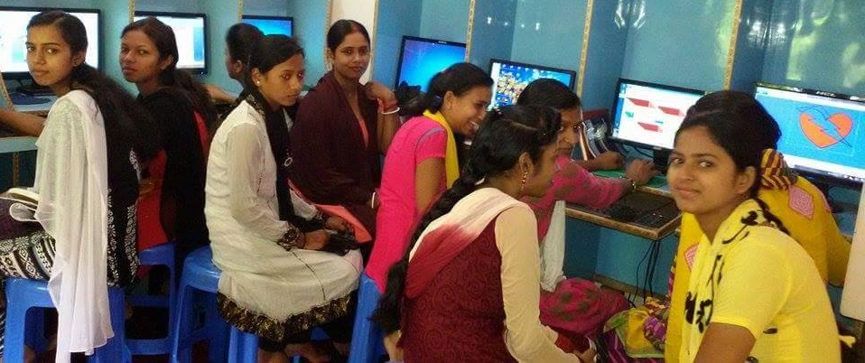 Young womens learning computers.